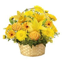 Online New Year Flowers Gifts Delivery in Ichalkaranji. Send Yellow Lily, Gerbera, Rose, Carnation Basket 12 Flowers in Ichalkaranji