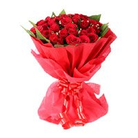 Online Valentine Flower Delivery in Gulbarga. Send Valentine Red Rose Bouquet in Crepe 24 Flowers in Gulbarga