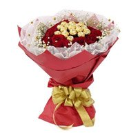 Online Valentines Day Gifts in Ambala. 16 Pcs Ferrero Rocher Chocolate encircled with 20 Red Roses