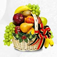 Birthday Gifts to Gwalior - An exclusive 2 Kg Fresh Fruits Basket with green fillers