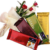 Place Online Order for 4 Cadbury Temptation Chocolates With 3 Red Roses Flowers to India on Rakhi