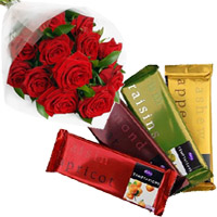 Online Gift of 4 Cadbury Temptation Bars with 12 Red Roses Bunch and Rakhi Flowers to India