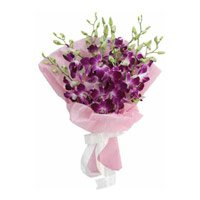 Send Flowers to India. Online Delivery of Purple Orchids in Crepe Paper