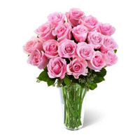 Send Flowers to India. Online Delivery of 24 Pink Roses in Vase Arrangement