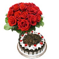 Flowers to India with 1/2 Kg Black Forest Cake and 12 Red Roses Bouquet