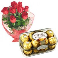 Valentine Flowers to India. Send 12 Red Roses and 16 pieces Ferrero Rocher to India on Valentine's Day