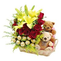 Send Mother's Day Gifts to Muzaffarnagar and send 2 Lily 12 Roses 16 Ferrero Rocher Twin Small Teddy Basket